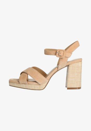 High heeled sandals - beige