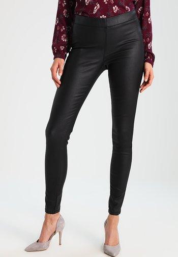 ADA COATED - Leggings - Trousers - black deep