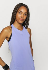 Nike Performance - TANK ALL OVER  - Camiseta de deporte - light thistle/white