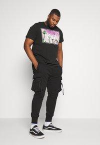 Urban Classics - TACTICAL PANTS - Tracksuit bottoms - black - 1