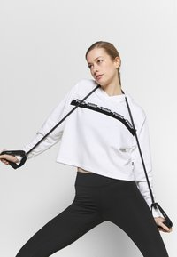 Puma - AMPLIFIED CROPPED HOODIE  - Mikina skapucí - white - 3