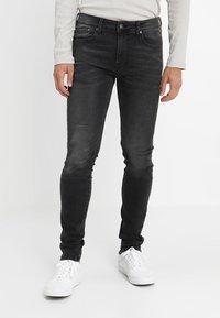 Pepe Jeans - FINSBURY - Jeans Skinny Fit - black denim - 0