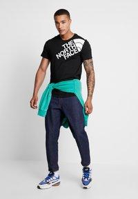 The North Face - SHOULDER LOGO TEE - Print T-shirt - black/white - 1