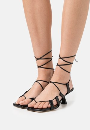 MALIA - T-bar sandals - black