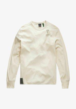 BACK GRAPHIC TWEETER - Long sleeved top - ecru