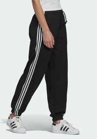 adidas Originals - FLEECE PANT ADICOLOR ORIGINALS RELAXED PANTS - Tracksuit bottoms - black - 2