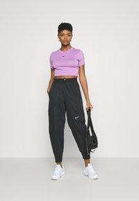 Nike Sportswear - PANT - Tracksuit bottoms - black - 1