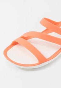 Crocs - SWIFTWATER - Pool slides - grapefruit/white - 2