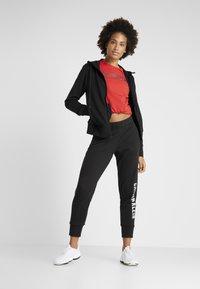Calvin Klein Performance - PANTS - Verryttelyhousut - black - 1
