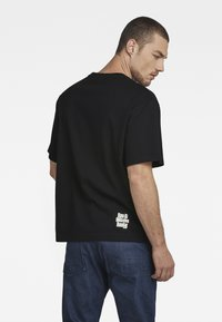G-Star - UNISEX RADIO BOXY R T - Print T-shirt - dry jersey o - dk black - 3