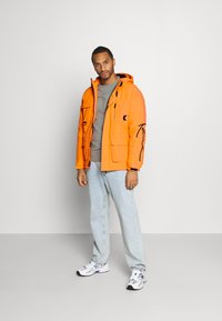 Karl Kani - SIGNATURE PADDED UTILITY JACKET - Winter coat - orange - 1