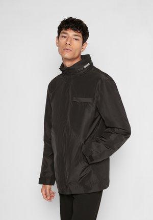 BRUCE TECH AMO - Light jacket - noir