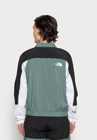 The North Face - WIND JACKET  - Giacca a vento - balsam green/black/white - 2