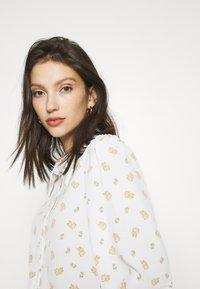 Monki - NALA BLOUSE - Button-down blouse - white light - 3