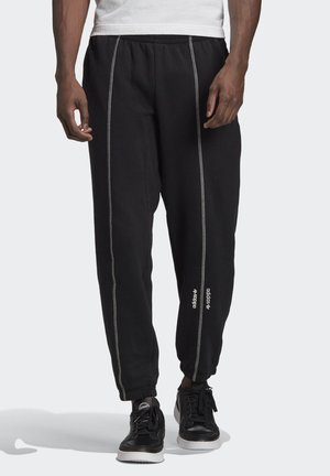 JOGGERS - Tracksuit bottoms - black