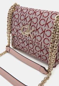 Calvin Klein - RE LOCK CROSSBODY - Across body bag - pink - 3