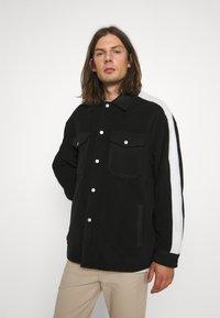 WRSTBHVR - GATY UNISEX - Fleece jacket - black - 0