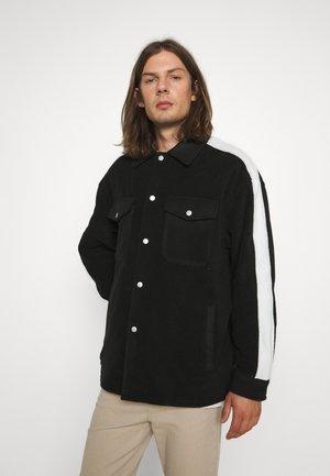 GATY UNISEX - Fleece jacket - black