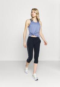 Champion - CAPRI PANTS - 3/4 sports trousers - dark blue - 1