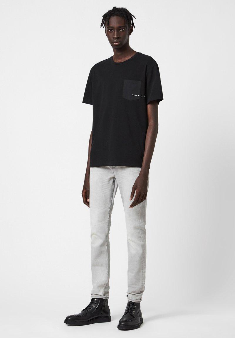 AllSaints CIGARETTE - Jeans Slim Fit - grey/grau IZ0Zv1