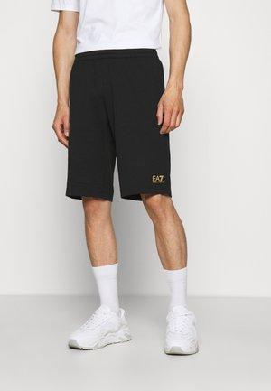 Pantaloni sportivi - black/gold-coloured