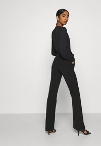 ONLY - ONLELORA ELLY LIFE FLARE PANT - Trousers - black - 4