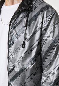 Emporio Armani - BLOUSON JACKET - Waterproof jacket - grey - 6