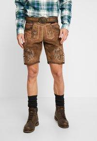 Krüger Dirndl - Pantaloni di pelle - brown - 0