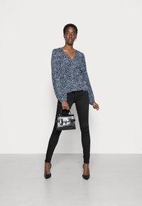 Vero Moda Tall - VMTANIA TALL - Long sleeved top - black - 1