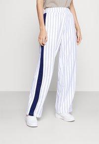 Fila - HALA TRACK PANTS - Trousers - blanc de blanc/black iris - 0