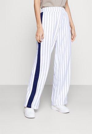 HALA TRACK PANTS - Pantalones - blanc de blanc/black iris