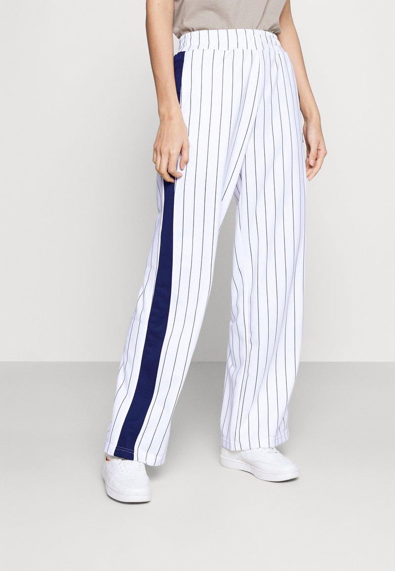 Fila - HALA TRACK PANTS - Trousers - blanc de blanc/black iris