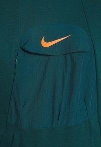 Nike Performance - HOODIE - Hoodie - atomic teal/black/electro orange - 5