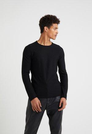RIK - Stickad tröja - black