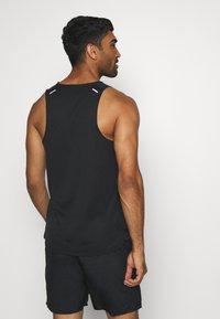 Nike Performance - RISE TANK - Sports shirt - black - 2