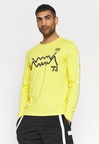 Puma - Long sleeved top - yellow - 0