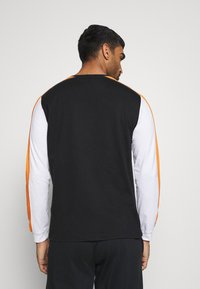 Champion - LONG SLEEVE - Long sleeved top - black - 2