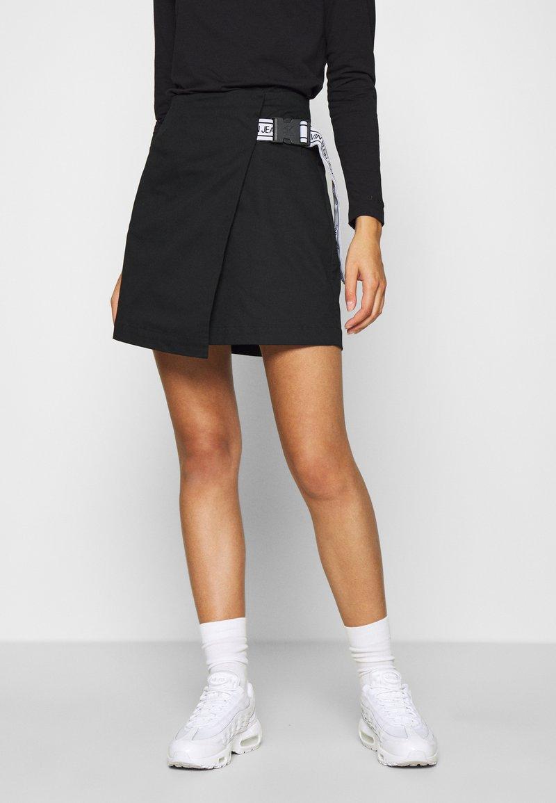 Calvin Klein Jeans - BUCKLE LOGO STRAP - Mini skirt - black