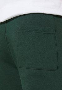 Pier One - Teplákové kalhoty - dark green - 7