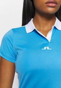 J.LINDEBERG - NOUR GOLF - Koszulka sportowa - ocean blue - 5
