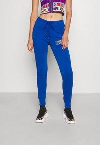 Versace Jeans Couture - PANTS - Tracksuit bottoms - blue - 0