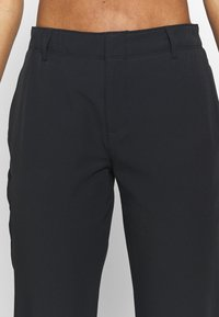 Under Armour - LINKS PANT - Trousers - black - 4