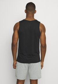 Nike Performance - TANK ATHLETE - Sports shirt - black/white - 2