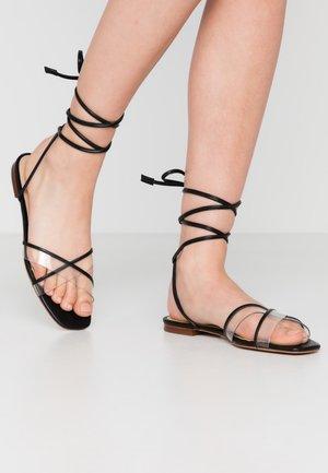 CANDID - Sandaalit nilkkaremmillä - black