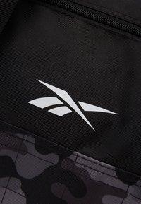 Reebok - ACT CORE GRIP UNISEX - Sports bag - black - 5