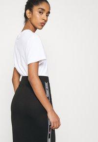 Tommy Jeans - BODYCON TAPE DETAIL SKIRT - Pencil skirt - black - 3
