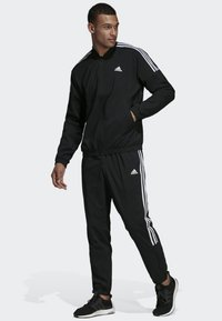 adidas Performance - Light Woven Track Suit - Träningsset - black - 1