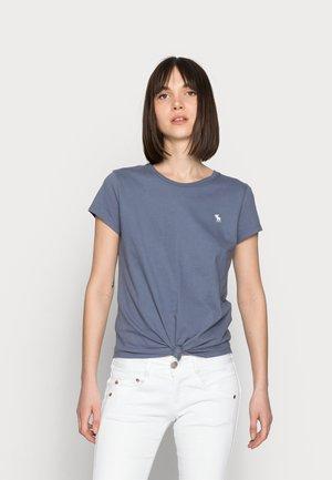 GILA SLIM STRETCH - Slim fit jeans - white