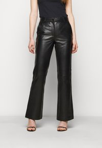 STUDIO ID - AMBER  - Leather trousers - black - 0
