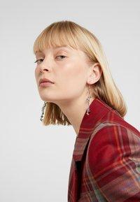 Vivienne Westwood - SKELETON EARRINGS - Earrings - palladium - 1